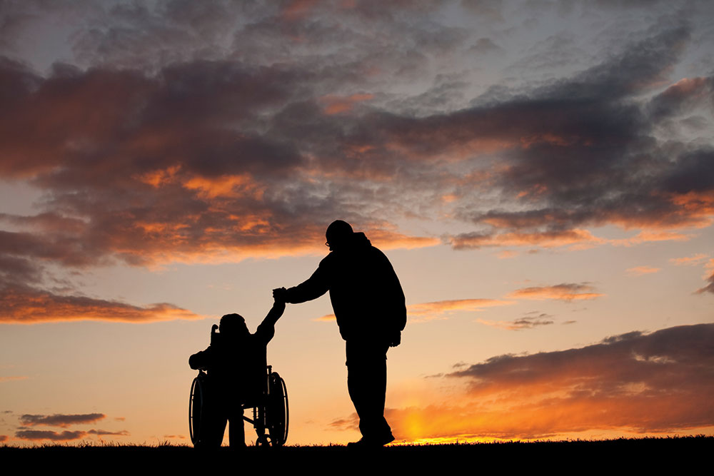 travel_23721354_father_and_child_wheelchair_1000x667