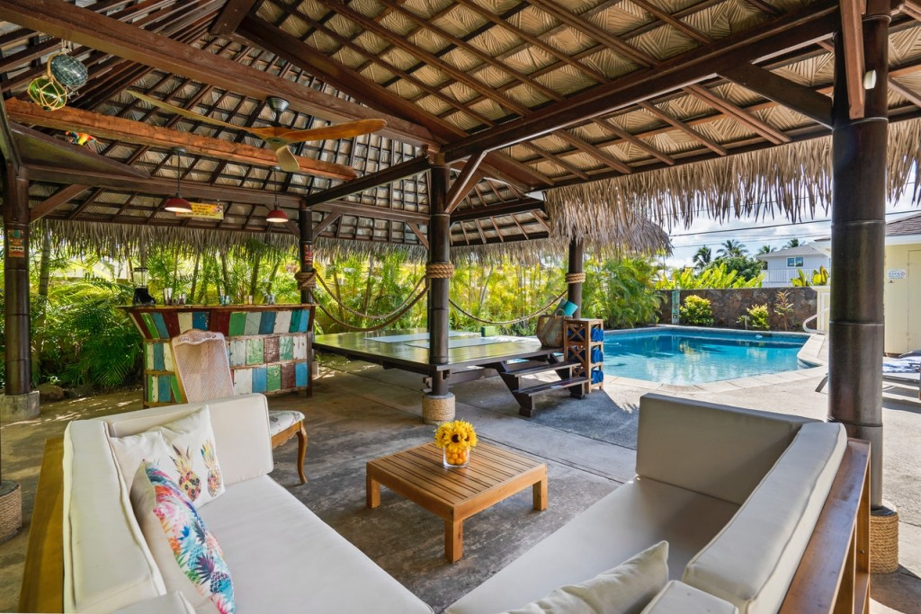 a-cozy-cabana-close-to-a-swimming-pool-3209049